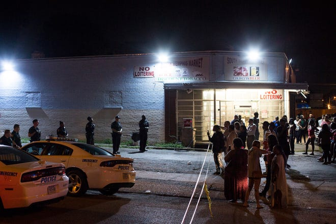 September 18 2018 - Memphis police form a line across Gill Avenue near the scene where a driver was shot and critically injured by a Memphis police officer Monday evening in South Memphis. The shooting followed a traffic stop in the 1200 block of Gill, which is near the intersection of South Parkway and Elvis Presley Boulevard. Martavious Banks, 25, was shot by an officer around 6 p.m. and taken in critical condition to Regional One Hospital, the police department said.