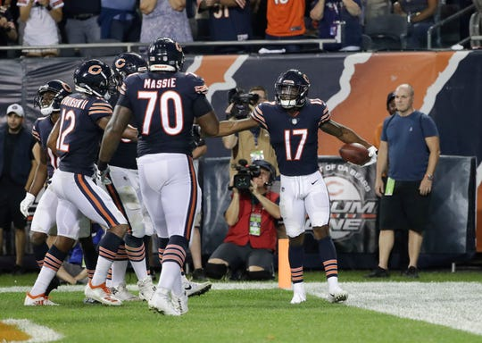 Chicago Bears wide receiver Anthony Miller (17) celebrates a touchdown with his teammates during the second half of an NFL football game against the Seattle Seahawks Monday, Sept. 17, 2018, in Chicago.
