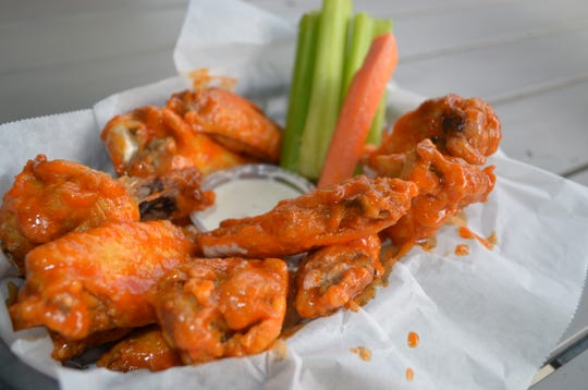 Chicken wings at the new Saucy Chicken in Crosstown Concourse. There are several signature sauces from which to choose.