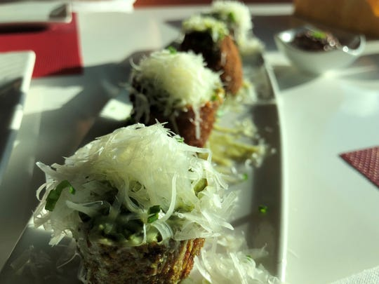 Lamoraga's mushroom roll, pounded pork tenderloin stuffed with mushroom ragout, topped with parmesan cheese and pesto.