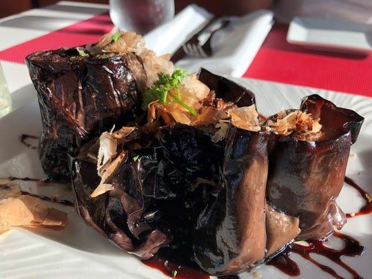 Lamoraga's dancing eggplant, blooming eggplant with mirin and honey sauce, sesame seeds and wobiko flakes.
