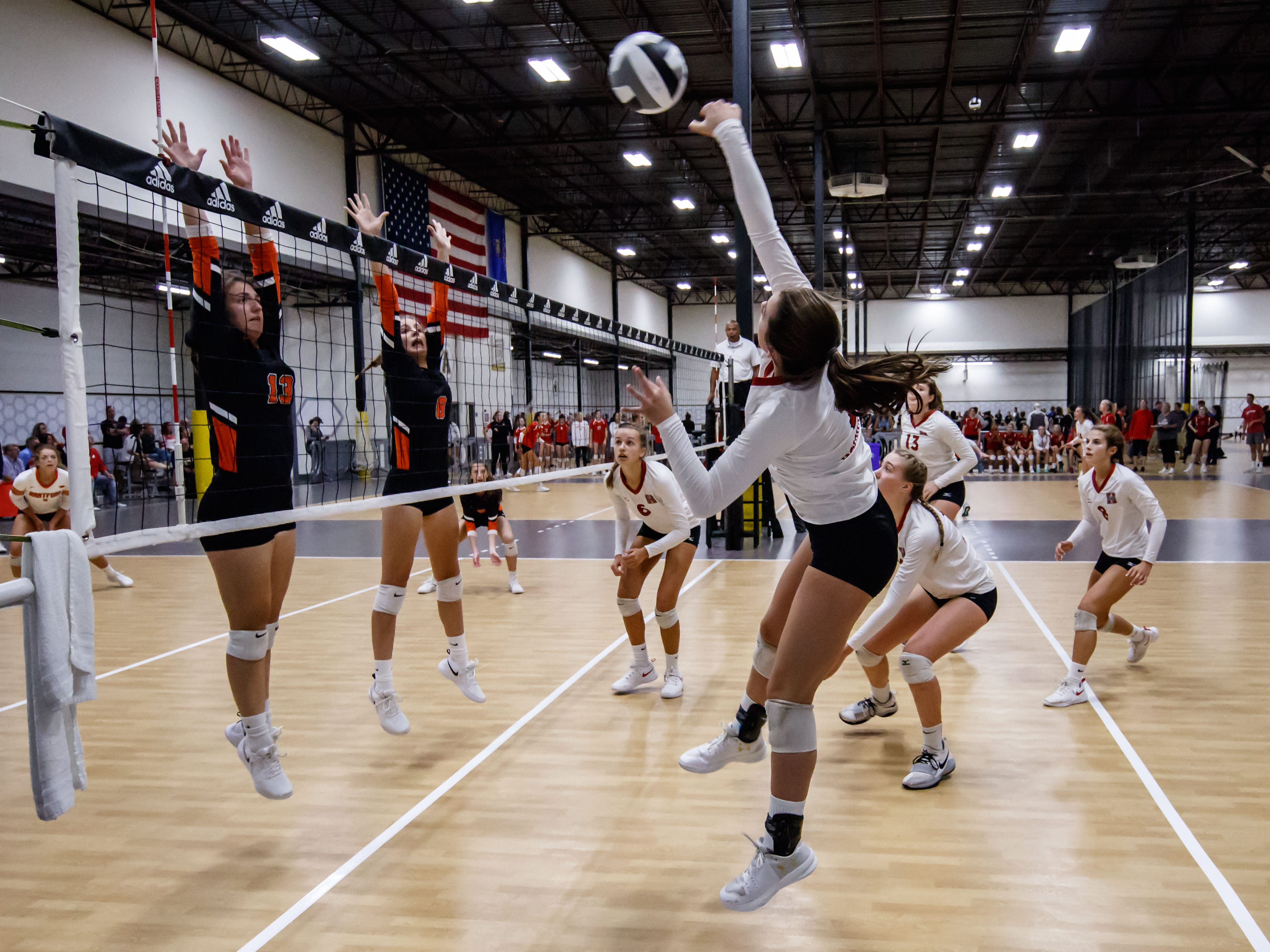 Sussex Hamilton junior Jessica Bagley (7) elevates for a kill during a match at the 2018 Eastbay Charger Challenge hosted by Sussex Hamilton at the Milwaukee Sting Center in Menomonee Falls on Saturday, Sept. 15.