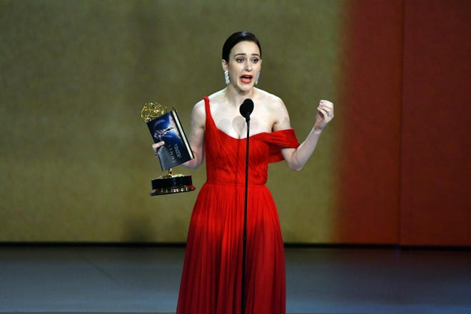 """Rachel Brosnahan accepts the award for lead actress in a comedy series for her role in """"The Marvelous Mrs. Maisel"""" at the Emmy Awards at the Microsoft Theater Monday night."""