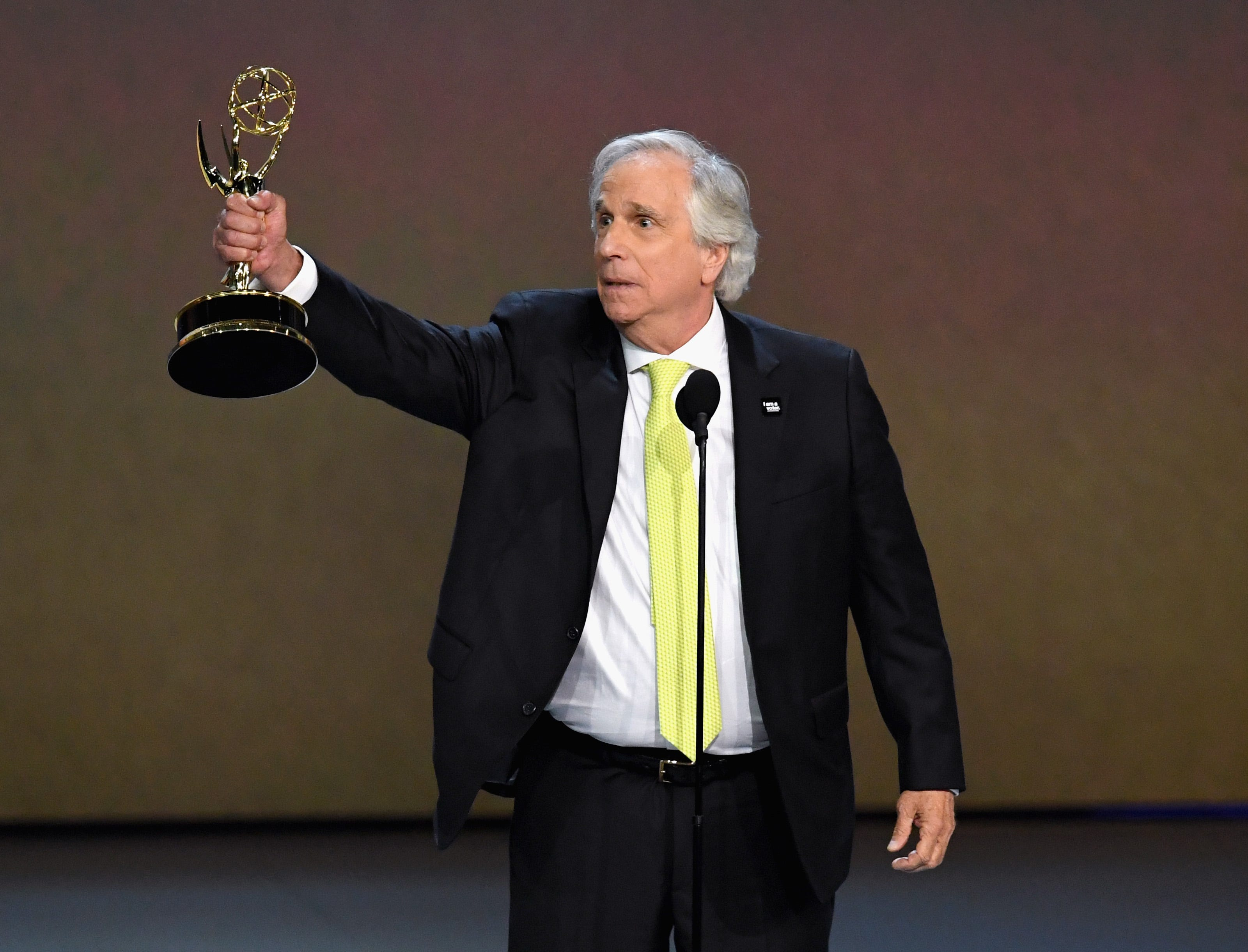 """Henry Winkler accepts the Emmy — his first ever — for supporting actor in a comedy series for HBO's """"Barry"""" Monday night at the 70th Emmy Awards."""