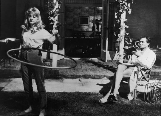 "Sue Lyon (left) and James Mason appear in a scene from the 1962 motion picture ""Lolita"" directed by Stanley Kubrick."
