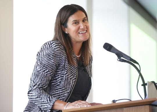 Allison Wagner, executive director of All-In Milwaukee, speaks during the launch of the nonprofit on Tuesday. All-In Milwaukee is aimed at helping low-income, high-potential students complete college.