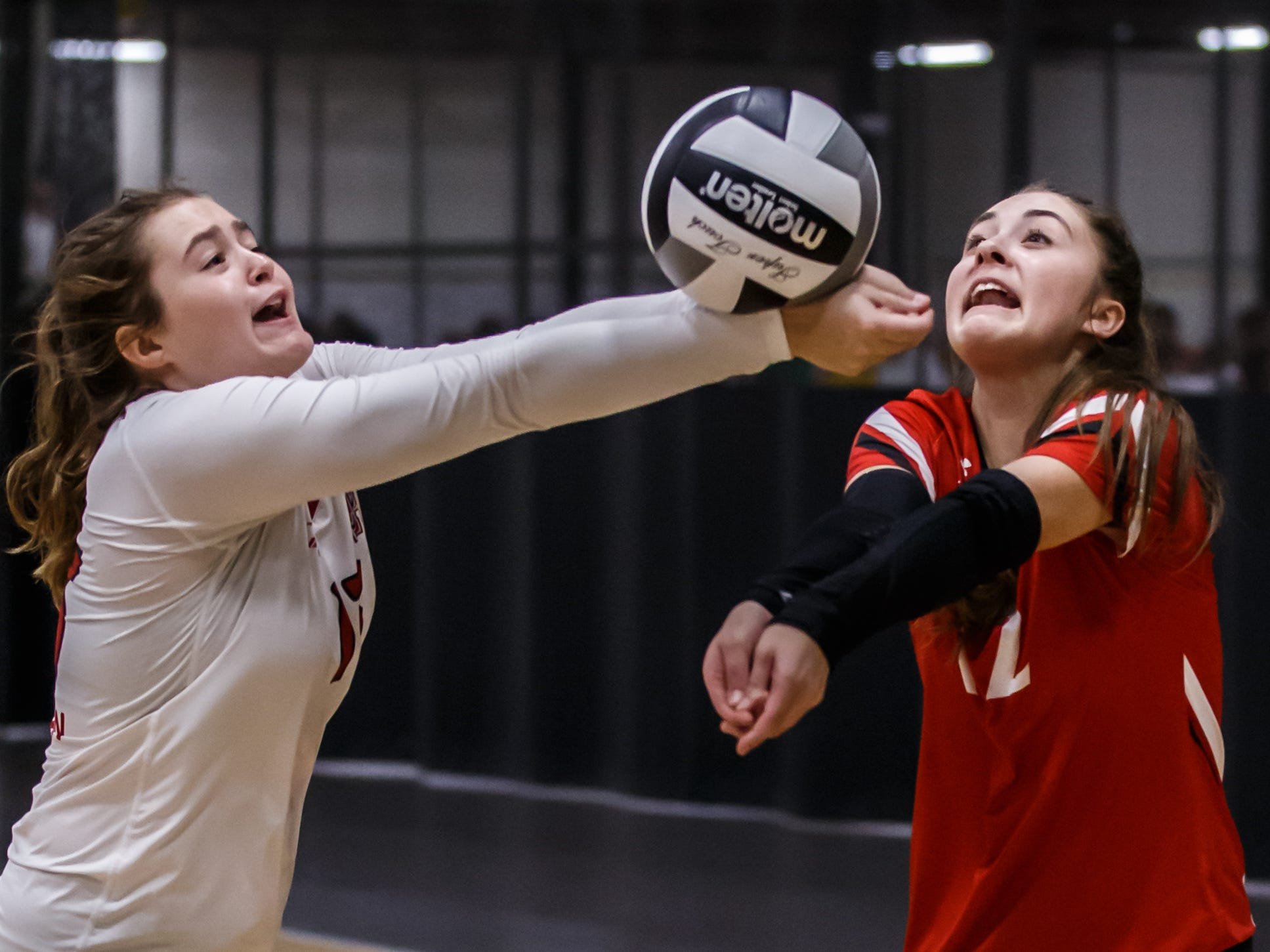 Sussex Hamilton's Katelyn Lefler (left) and Megan Hawthorne (12) chase down a tipped ball during a match at the 2018 Eastbay Charger Challenge hosted by Sussex Hamilton at the Milwaukee Sting Center in Menomonee Falls on Saturday, Sept. 15.