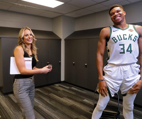Katie George, the new sideline reporter for the Milwaukee Bucks, prepares to ask Giannis Antetokounmpo questions ranging from his favorite food and routines to things he has noticed about other players on the team. She was producing promotional and marketing videos for the 2018-'19 season.