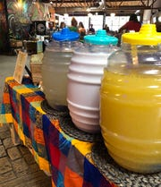 Three of Algo Dulce's agua frescas (front to back): strawberry lime and lemon basil, pineapple mango and lime, and cactus prickly pear and lime.