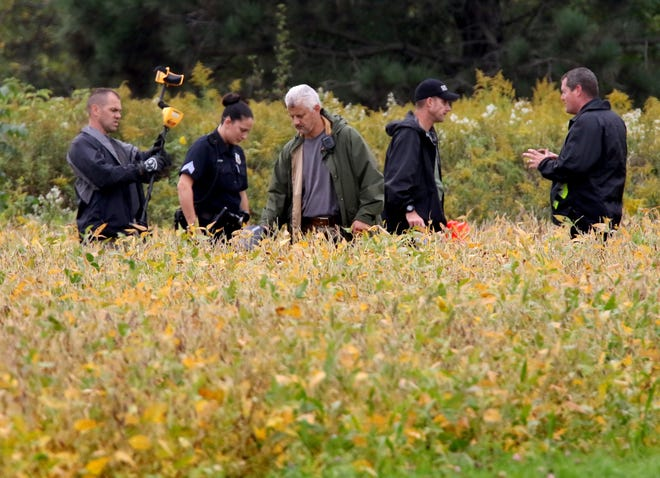 Law enforcement personnel investigate a farm field due south of 18350 W. Coffee Road in New Berlin on Sept. 18 following an explosion that was reported at 4:20 pm on Sept. 17. Coffee Road was closed in that vicinity during a portion of the investigation.
