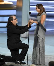 "Glenn Weiss  (left), winner of the Emmy for best director Outstanding Directing of a variety special ""The Oscars,"" proposes marriage to Jan Svendsen onstage during the 70th Emmy Awards Monday night."