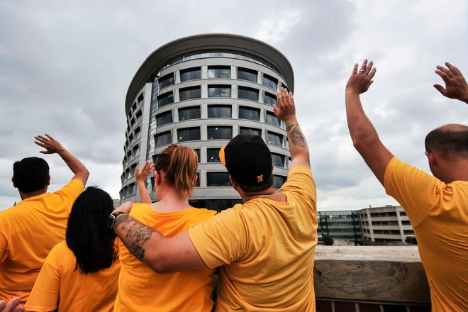 Iowa Hawkeyes fans wave to the University of Iowa Childrens Hospital at the end of the first quarter against Northern Illinois at Kinnick Stadium.