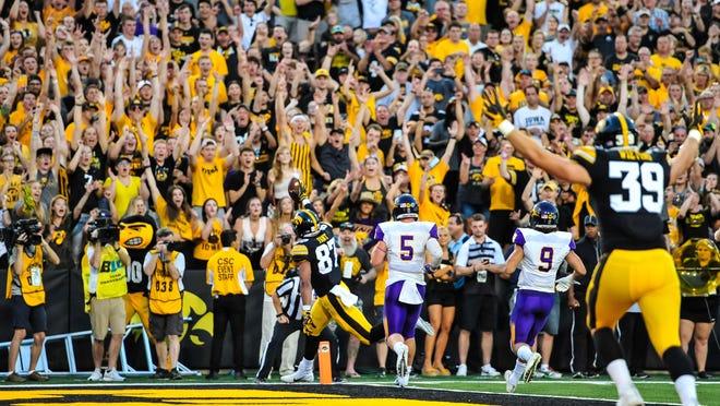 Iowa Hawkeyes fans cheer at touchdown against Northern Iowa last weekend at Kinnick Stadium.