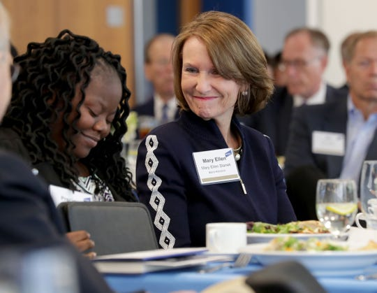 Robert W. Baird executive Mary Ellen Stanek (right) smiles as Precious Drew is introduced at the launch of All-In Milwaukee on Tuesday. All-In Milwaukee is a nonprofit focused on helping low-income, high-potential students complete college.