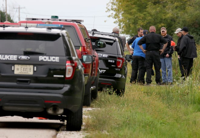 Law enforcement personnel investigate in the vicinity of 18350 W. Coffee Road in New Berlin on Sept. 18 following an explosion that was reported at 4:20 pm on Sept. 17. Coffee Road was closed during a portion of the investigation.