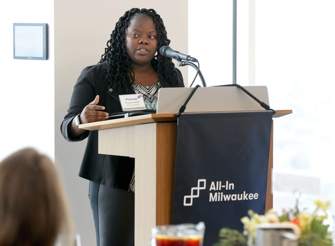 Precious Drew speaks during the launch of All-In Milwaukee at the Baird Conference Center in Milwaukee on Tuesday. All-In Milwaukee, a new nonprofit aimed at helping low-income, high-potential students complete college, is an expansion of the Minneapolis-based Wallin Education Partners. Drew is a product of the Wallin program in the Twin Cities.