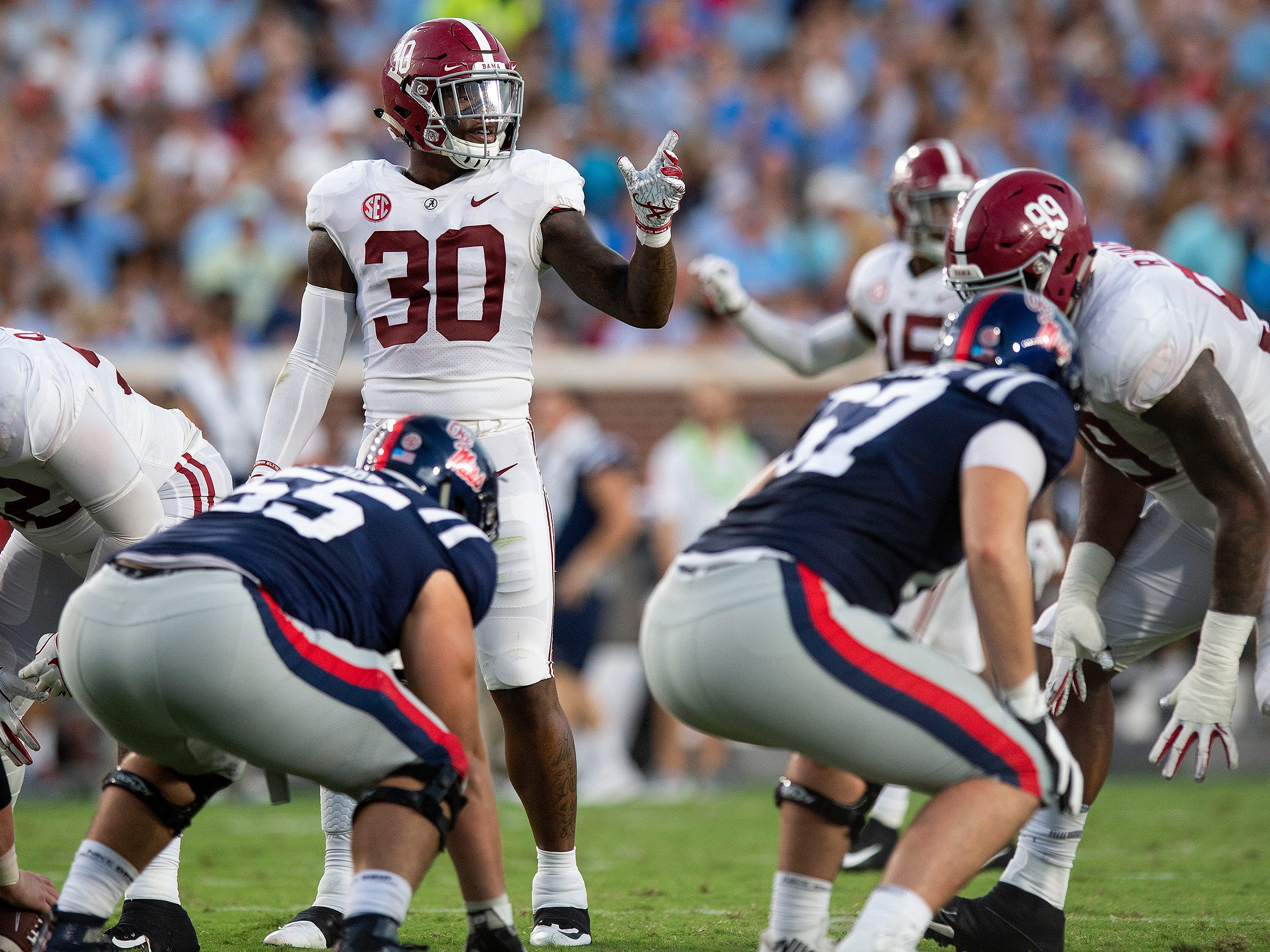 Alabama linebacker Mack Wilson (30) directs the defense against Ole Miss in first half action in Oxford, Ms., on Saturday September 15, 2018.