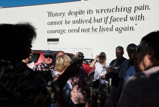 Michelle Browder, left, leads a group of British tourist through a tour outside The Legacy Museum in Montgomery, Ala., on Sunday, Sept. 16, 2018.