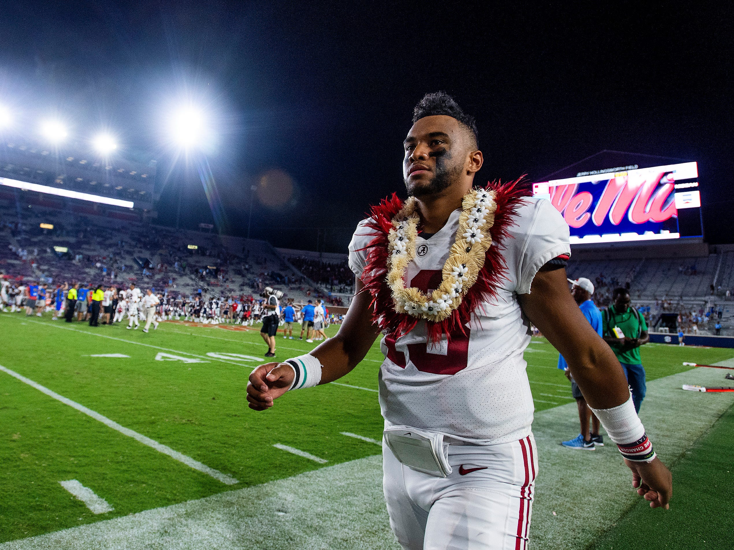 Alabama quarterback Tua Tagovailoa (13) wears a lei given to him by his mother Diane Tagovailoa after Alabama defeated Ole Miss in Oxford, Ms., on Saturday September 15, 2018.