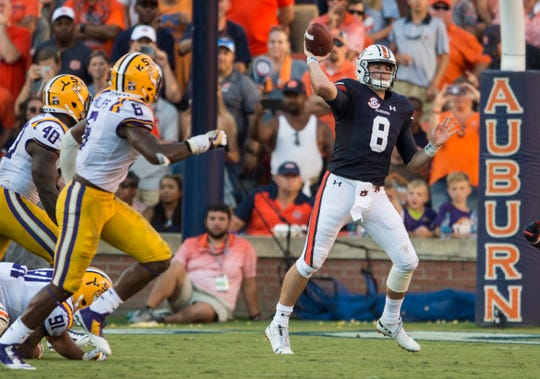 Auburn's Jarrett Stidham (8) passes the ball down the field at Jordan-Hare Stadium in Auburn, Ala., on Saturday, Sept. 15, 2018. LSU defeated Auburn 22-21.