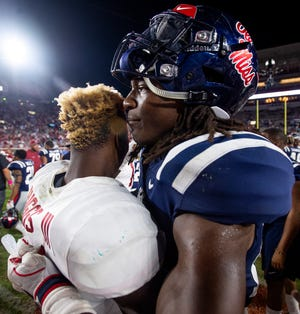 Ole Miss linebacker Kevontae' Ruggs (27)  and Alabama wide receiver Henry Ruggs, III, (11) chat after their game in Oxford, Ms., on Saturday September 15, 2018.