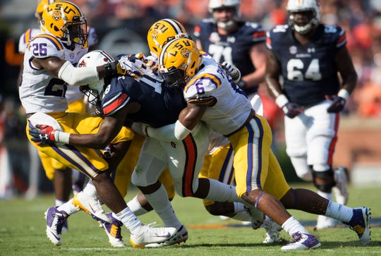 Auburn's Seth Williams (18) is taken down by a swarm of LSU defenders at Jordan-Hare Stadium in Auburn, Ala., on Saturday, Sept. 15, 2018. LSU defeated Auburn 22-21.