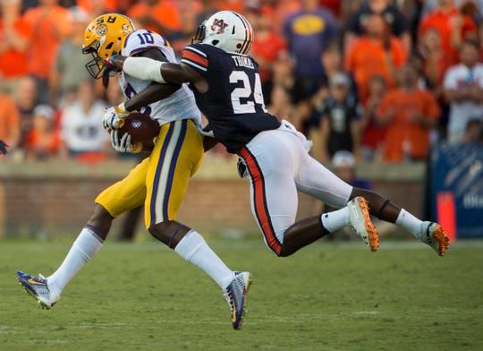 Auburn's Daniel Thomas (24) tackles LSU's Stephen Sullivan (10) at Jordan-Hare Stadium in Auburn, Ala., on Saturday, Sept. 15, 2018. LSU defeated Auburn 22-21.