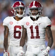 Alabama wide receiver Henry Ruggs, III, (11) and wide receiver DeVonta Smith (6) against Ole Miss in first half action in Oxford, Ms., on Saturday September 15, 2018.