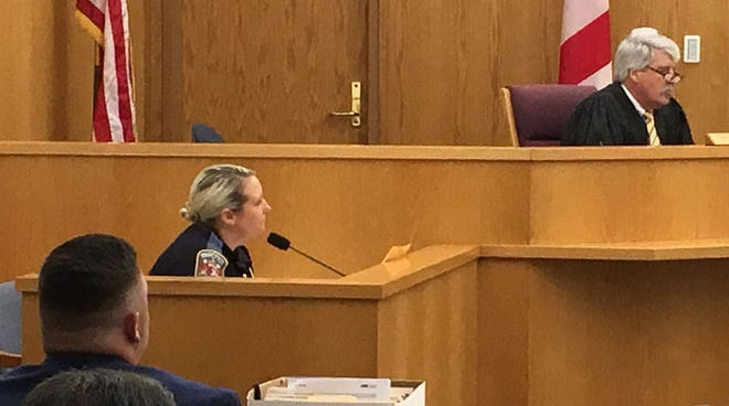 Cpl. Mary Ann Church, Alabama State Trooper testifies in Andrew Bass manslaughter trial. Bass is in the foreground with Circuit Judge Sibley Reynolds on the bench.