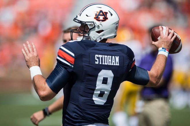 Auburn's Jarrett Stidham (8) warms up before his team takes on LSU at Jordan-Hare Stadium in Auburn, Ala., on Saturday, Sept. 15, 2018. LSU defeated Auburn 22-21.
