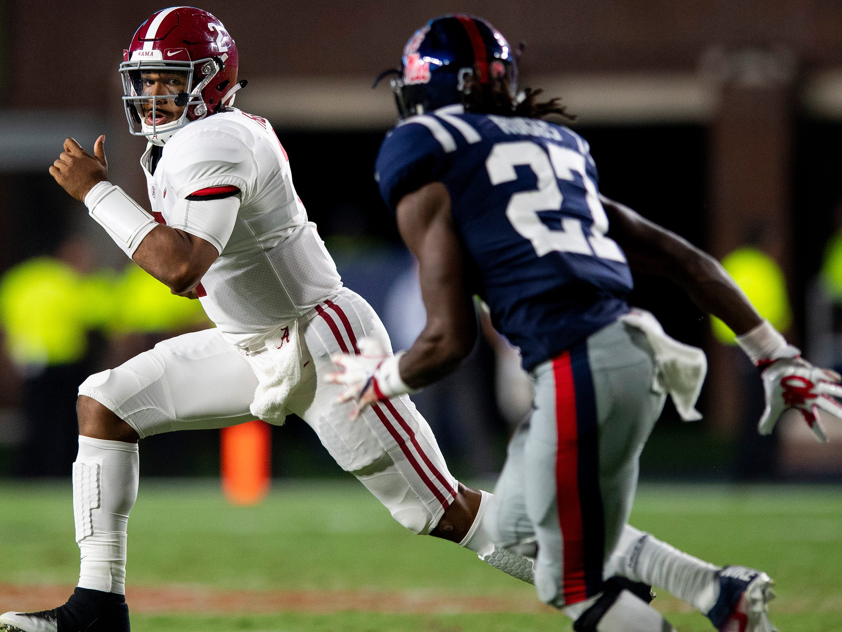 Alabama quarterback Jalen Hurts (2) carries against Ole Miss in first half action in Oxford, Ms., on Saturday September 15, 2018.
