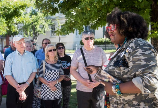 Michelle Browder, right, leads a group of British tourist through a tour outside The Legacy Museum in Montgomery, Ala., on Sunday, Sept. 16, 2018.