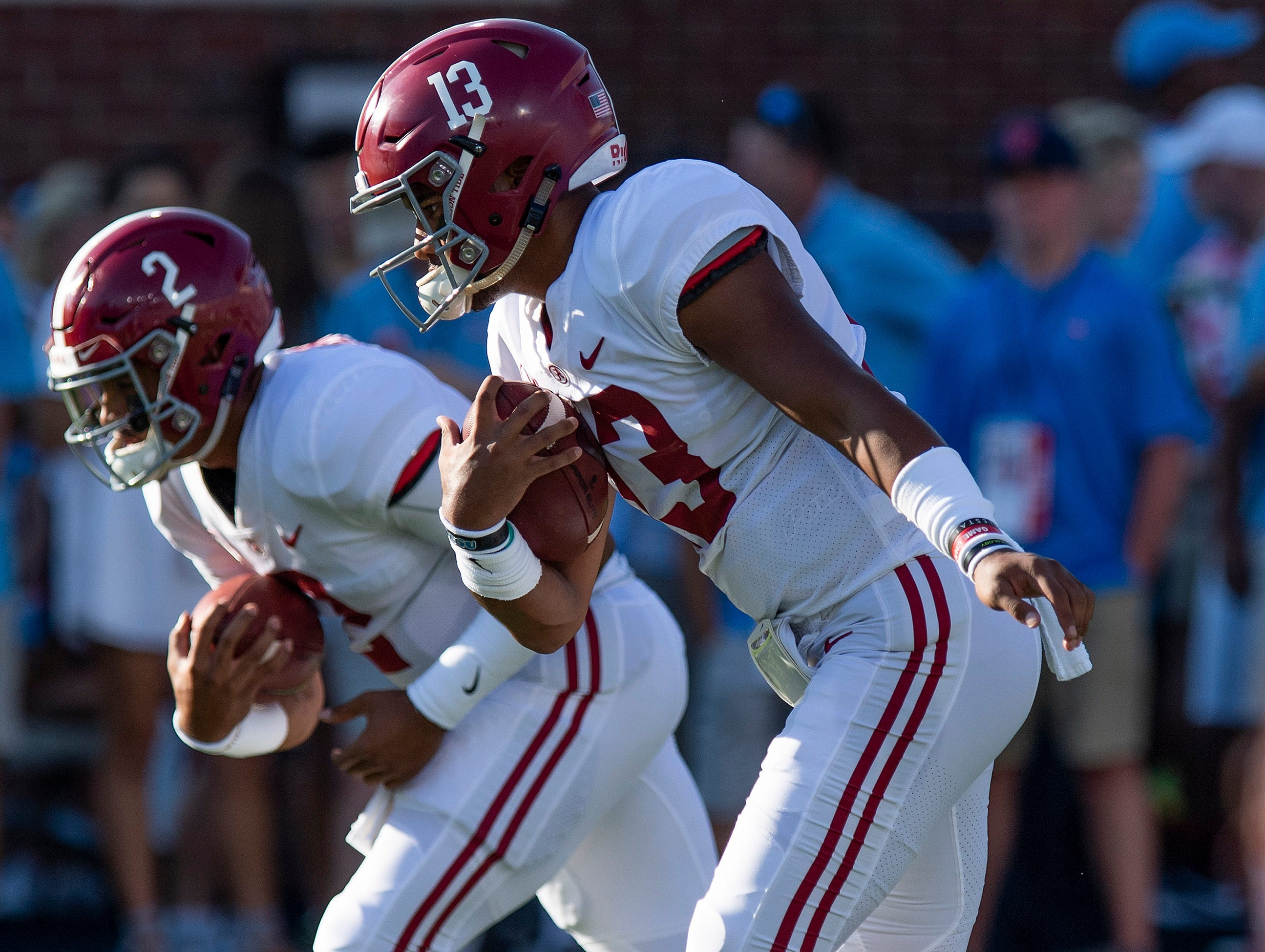 Alabama quarterbacks Tua Tagovailoa (13) and Jalen Hurts (2) as the Alabama football team warms up before the Ole Miss game in Oxford, Ms., on Saturday September 15, 2018.