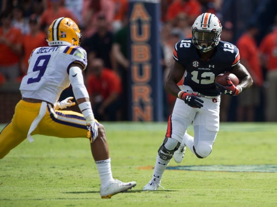 Auburn's Eli Stove (12) carries the ball down the field against LSU at Jordan-Hare Stadium in Auburn, Ala., on Saturday, Sept. 15, 2018. LSU defeated Auburn 22-21.
