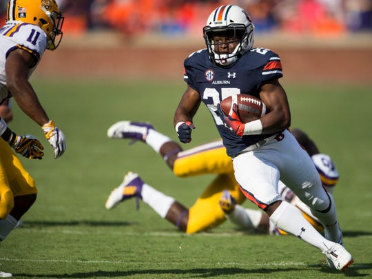 Auburn's Shaun Shivers (25) carries the ball against LSU at Jordan-Hare Stadium in Auburn, Ala., on Saturday, Sept. 15, 2018. LSU defeated Auburn 22-21.