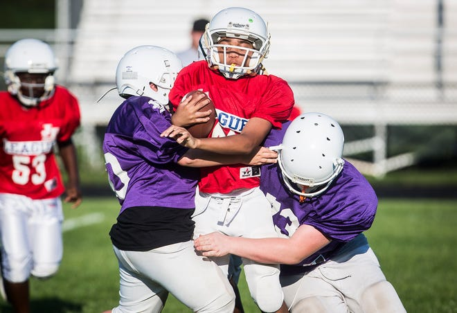 Pee wee football teams compete in the Youth Football League at Southside Middle School.