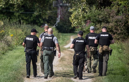 Dozens of police officers, with help from K-9 officers and drones, combed through a cornfield and adjacent wooded area north of County Road 350 N. in search of Brady Allen Turner, 25, who is suspected of fatally stabbing Christopher Eugene Burgess Jr. during a dispute on East 15th Street shortly before 9 p.m. Tuesday.