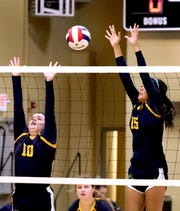 Providence Christian's Marley McCauley (10) and Kaici Bivens (15) defend a shot during a recent match.