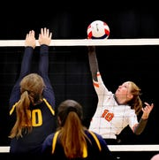 MTCS senior Mackenzie Harris goes for a kill during a recent match.