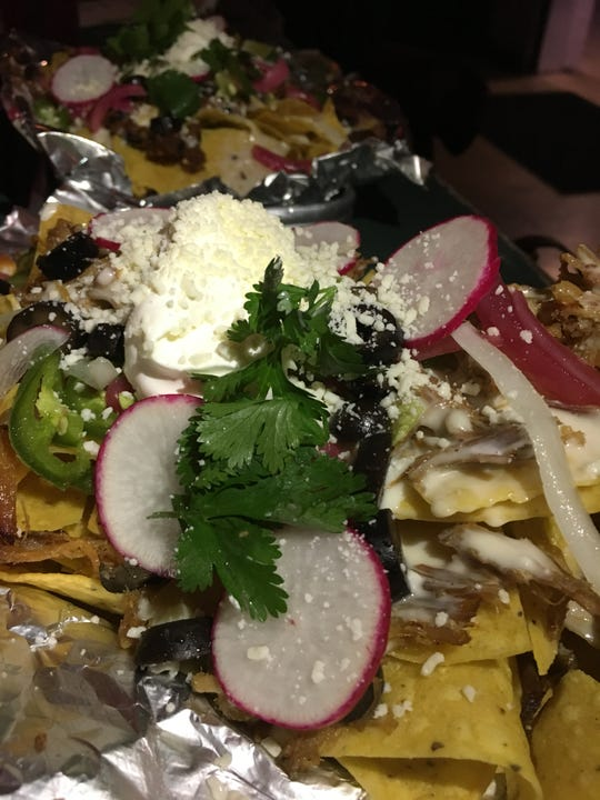 Radishes on nachos? You'll find that extra crunch at the bar at Bastion in Wedgewood-Houston