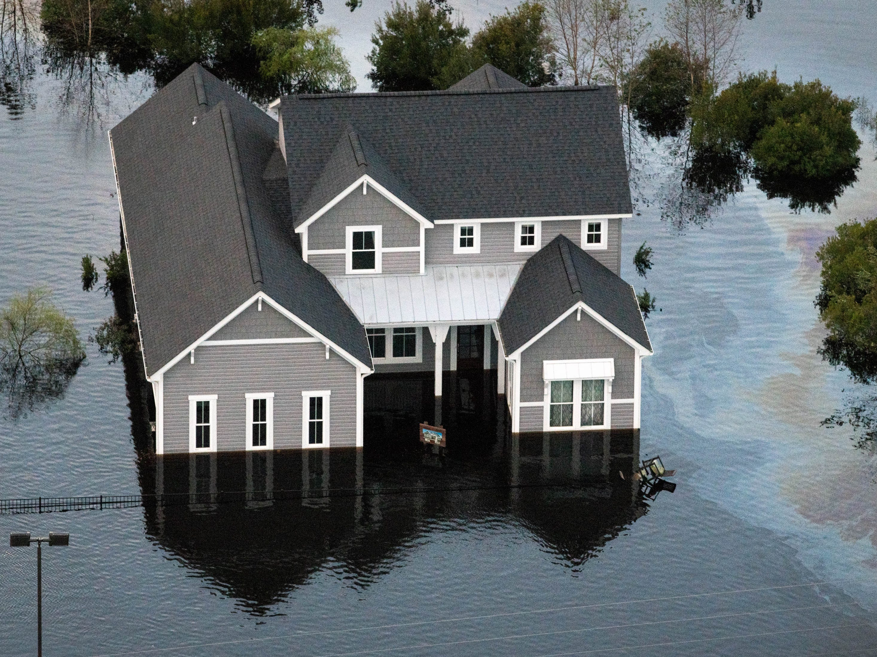 A flooded home in Brunswick County, N.C., as seen from a Coast Guard helicopter, Monday, Sept. 17, 2018.
