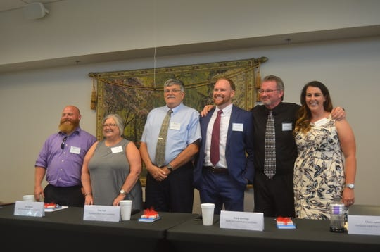 All six candidates for alderman in Portland stood at the end of the Portland Chamber of Commerce's political forum Sept. 18 at Volunteer State Bank.