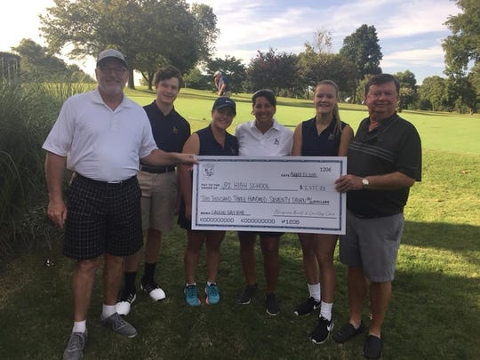 Pope John Paul II High School received $2,377.33 from Bluegrass Yacht and Country Club's Caddie Day.