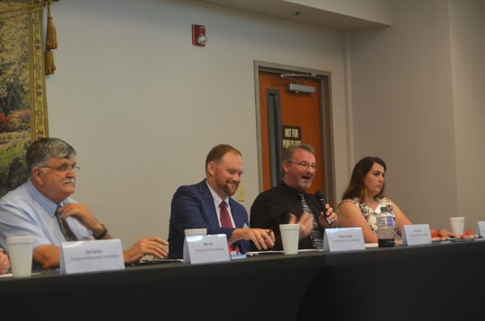 Portland alderman candidate Chuck Lyons answers a question at the Portland Chamber of Commerce's political forum Sept. 18 at Volunteer State Bank.