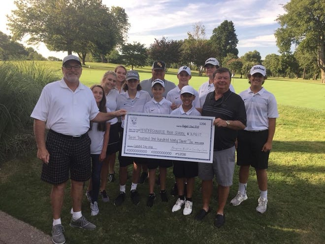 Hendersonville High School received $3,193.17 from Bluegrass Yacht and Country Club's Caddie Day.