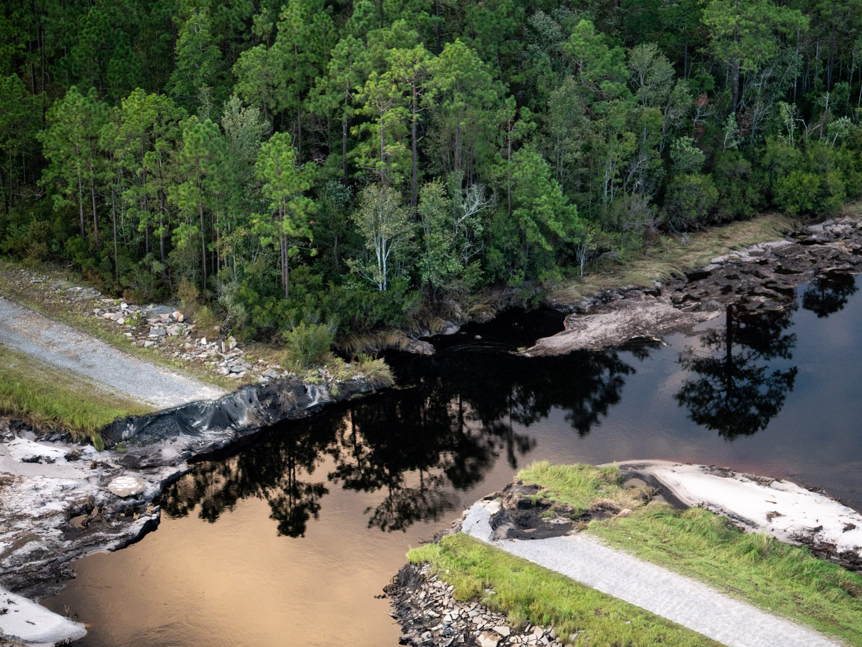 Flood damage, as seen from a Coast Guard helicopter, in Brunswick County, N.C., Monday, Sept. 17, 2018.
