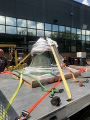 It took at least four firefighters to move Gallatin's historic fire hall bell to the truck so it could be restored.