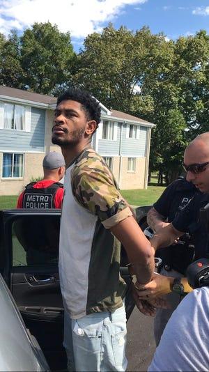 Deandre Sherrill shown being taken into custody.