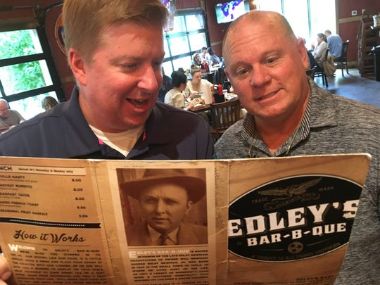 Tennessean sports writers Joe Rexrode, left, and Mike Organ look for nachos on the menu at Edley's Bar-B-Que in Sylvan Park
