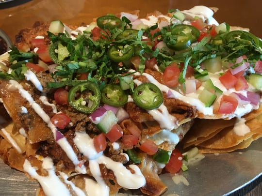 The flavorful lamb and extra crunchy fried nan chips make the nachos at Chauhan Ale and Masala House extraordinary
